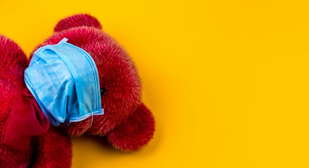 red teddy bear with blue surgical mask